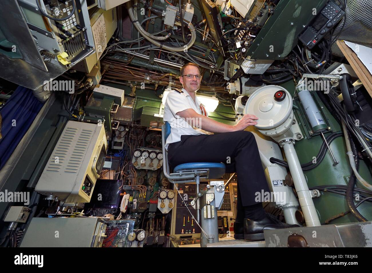 France, Var, Toulon, the naval base (Arsenal), Commander Nicolas Faure at periscope in the central navigation and operation room, Commander of the nuclear attack submarine (SNA) Casabianca (Rubis type) - Stock Image