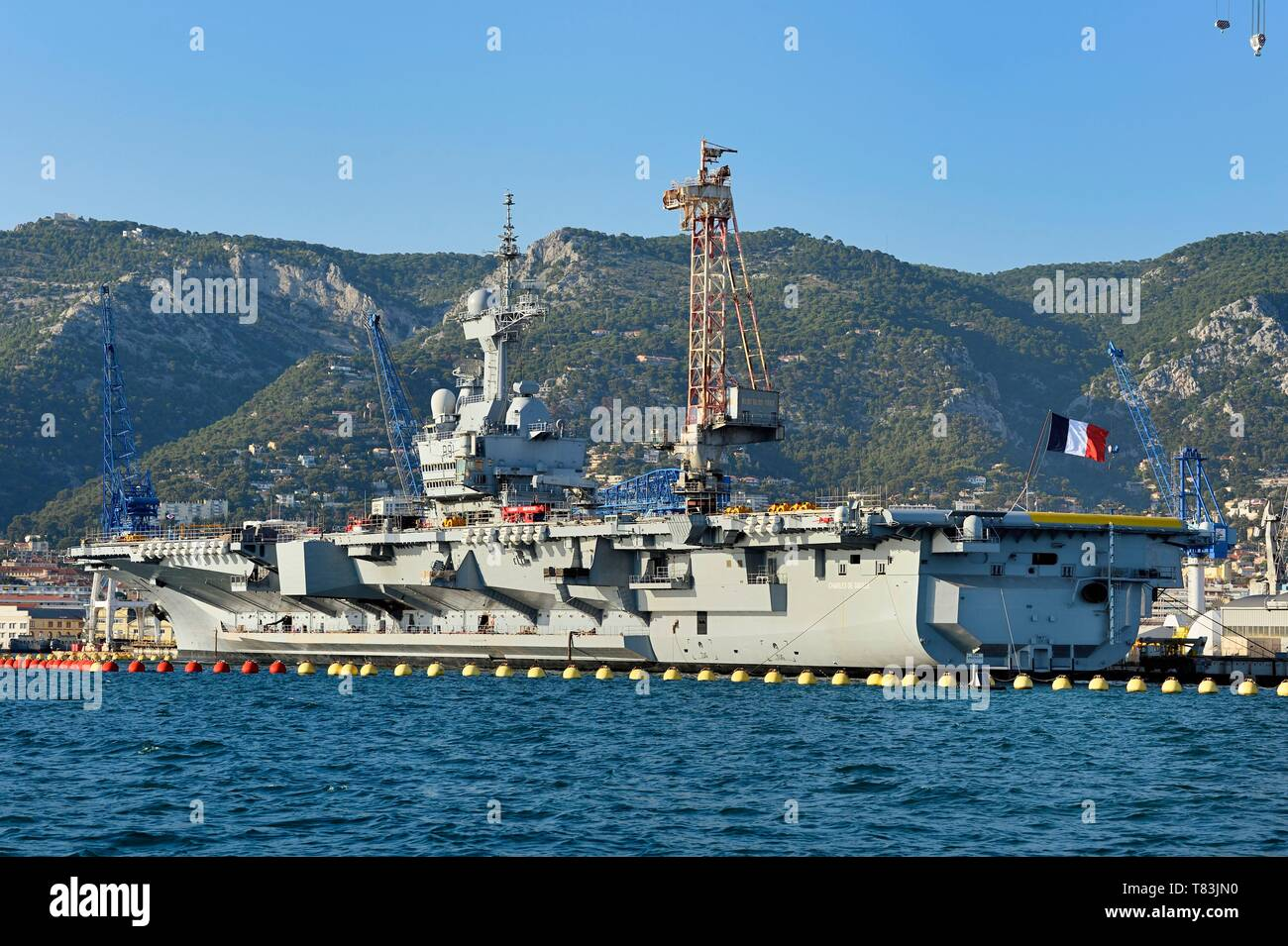 France, Var, Toulon, the naval base (Arsenal), the Charles de Gaulle nuclear powered aircraft carrier on mid life renovation - Stock Image
