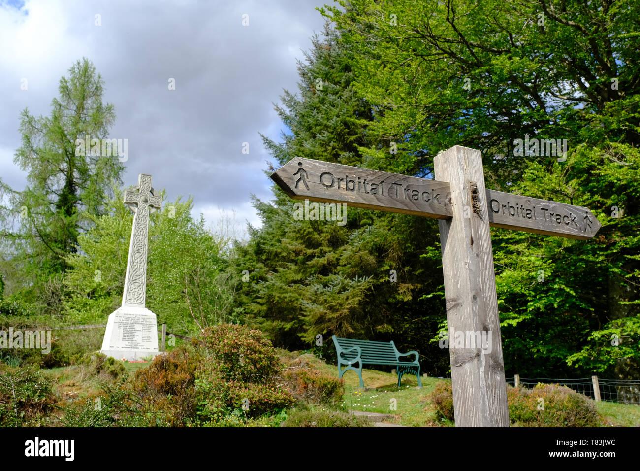 The Orbital Track around Glencoe village where it passes the War Memorial. - Stock Image