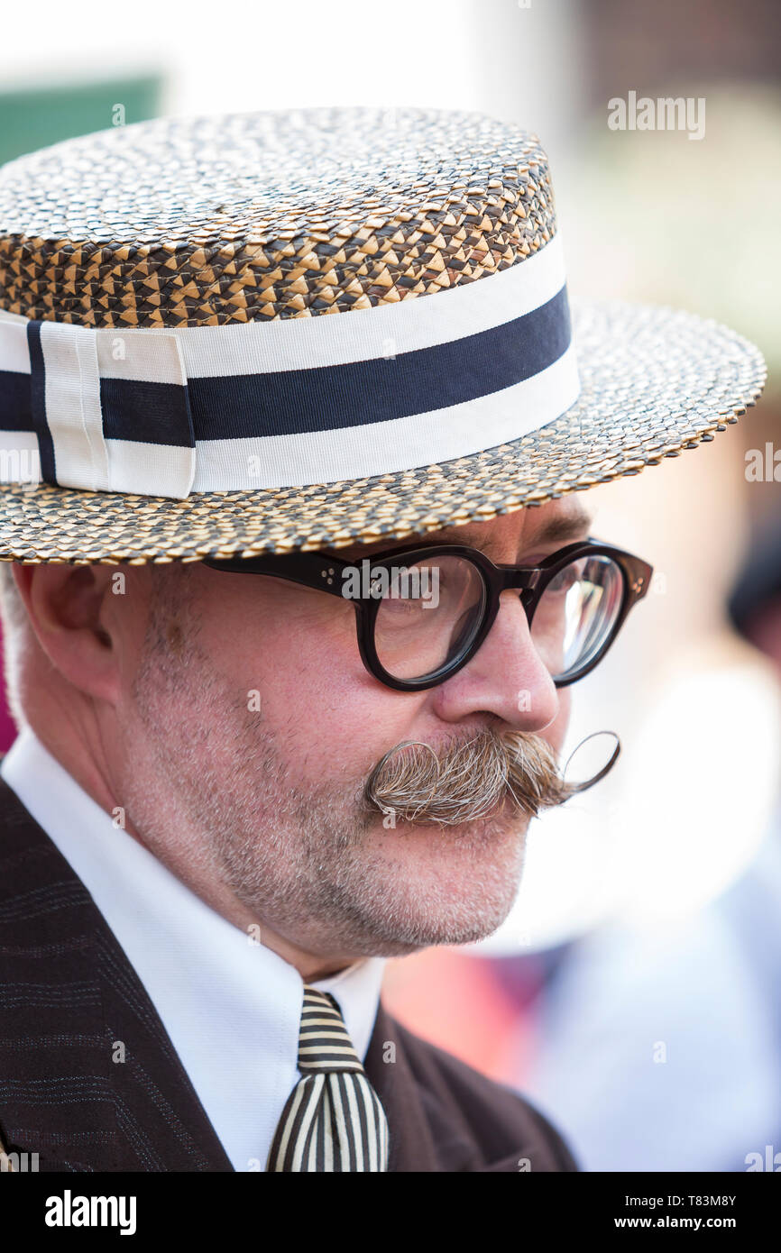 Close up portrait of smart man with fancy, grey handlebar moustache & glasses, wearing straw boater, Black Country Museum 1940's wartime event, 2018. - Stock Image