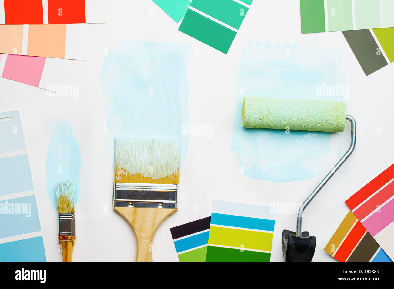 Picture of palette with blue and green colors, roller, brushes - Stock Image