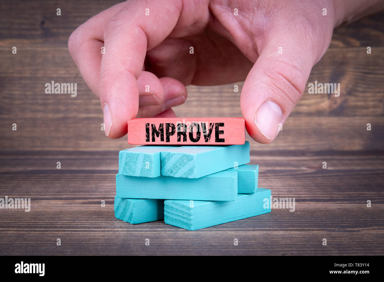 IMPROVE concept, With Colorful Wooden Blocks - Stock Image