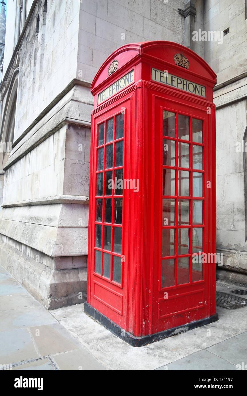 London phone box - red telephone kiosk in the UK. - Stock Image