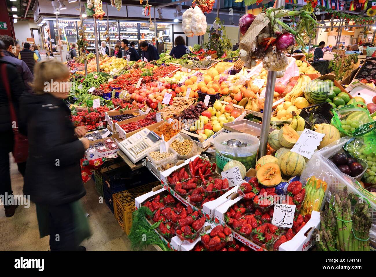 FLORENCE, ITALY - APRIL 30, 2015: People buy fruit at Mercato Centrale market in Florence, Italy. The market is an ultimate Italian shopping experienc - Stock Image