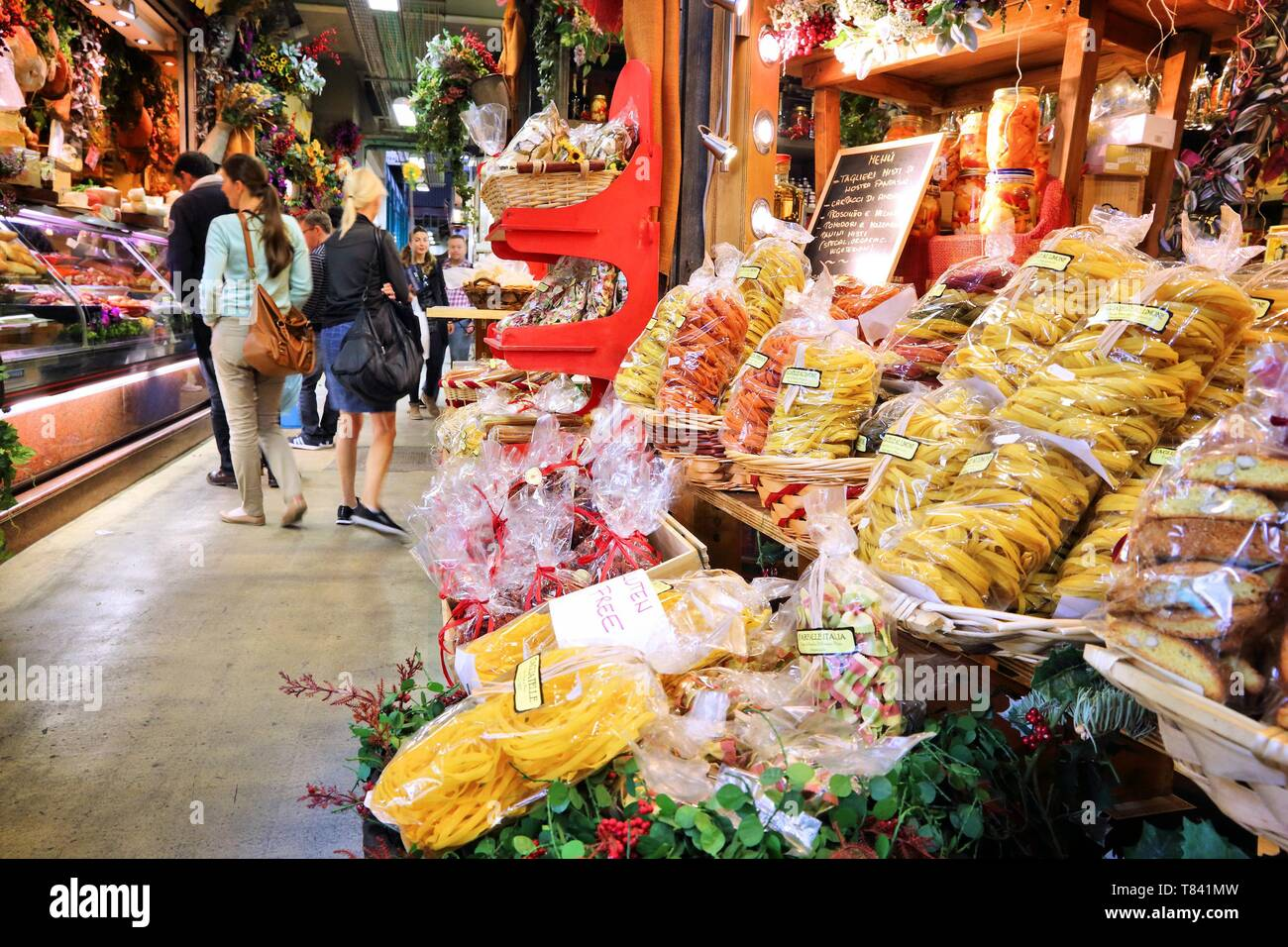 FLORENCE, ITALY - APRIL 30, 2015: People shop at Mercato Centrale market in Florence, Italy. The market is an ultimate Italian shopping experience. It - Stock Image