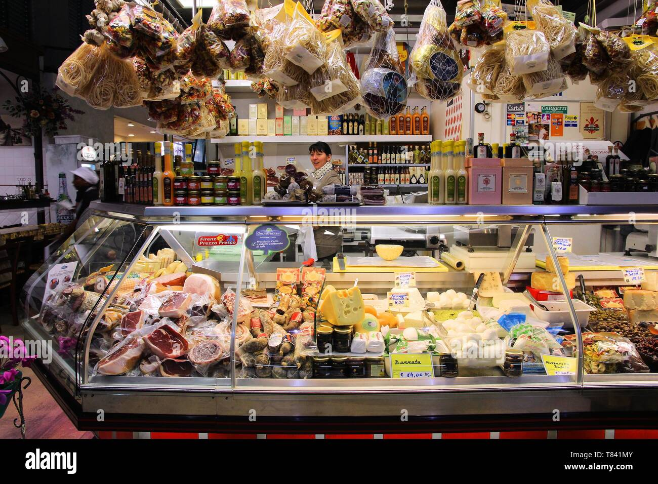 FLORENCE, ITALY - APRIL 30, 2015: Vendor sells cheese at Mercato Centrale market in Florence, Italy. The market is an ultimate Italian shopping experi - Stock Image