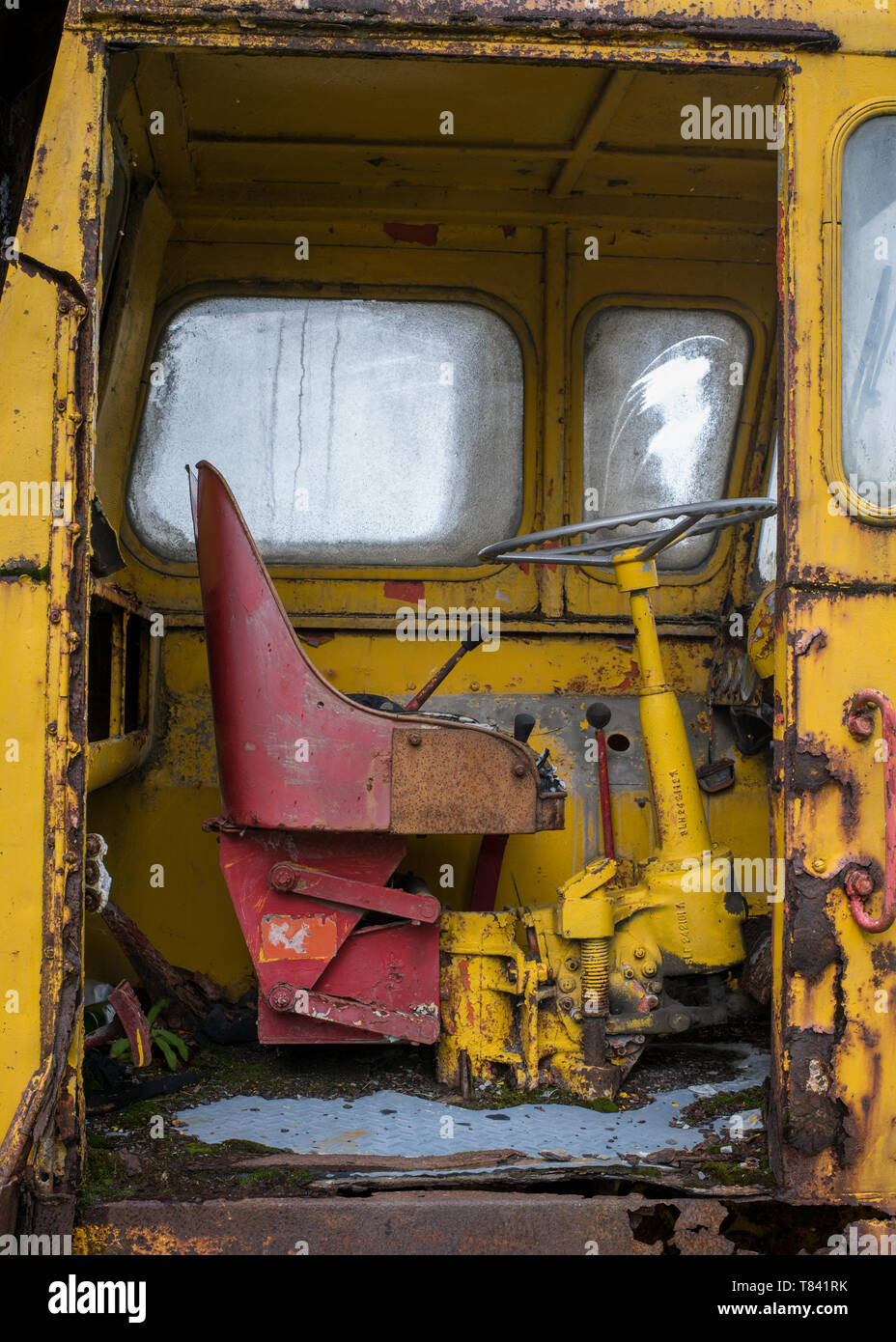 The cabin section of an old, rusting, abandoned heavy lifting crane at the Mining Museum, Lake District, Cumbria, UK - Stock Image