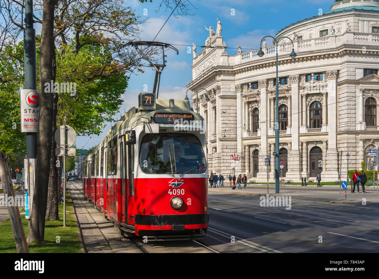 Ringstrasse Vienna, view of a tram on the Ringstrasse in central Vienna with the national theatre building (Burgtheater) in the background, Austria. Stock Photo