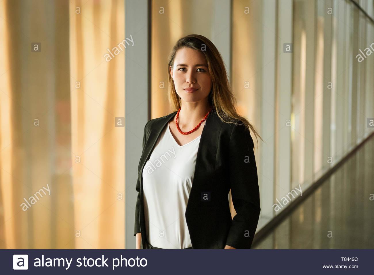 Young woman in corridor Stock Photo