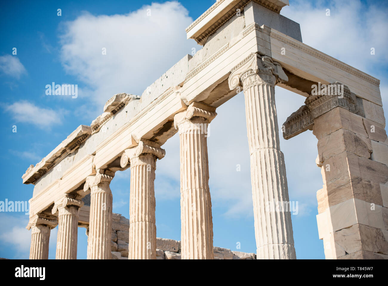 The Erechtheion is a structure on the north side of the Acropolis that was dedicated to the Greek gods Athena and Poseidon. The Acropolis of Athens is - Stock Image
