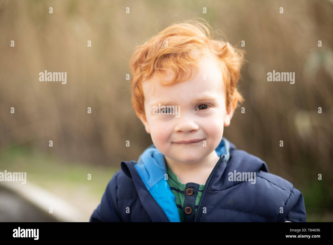 Portrait of boy with red hair Stock Photo