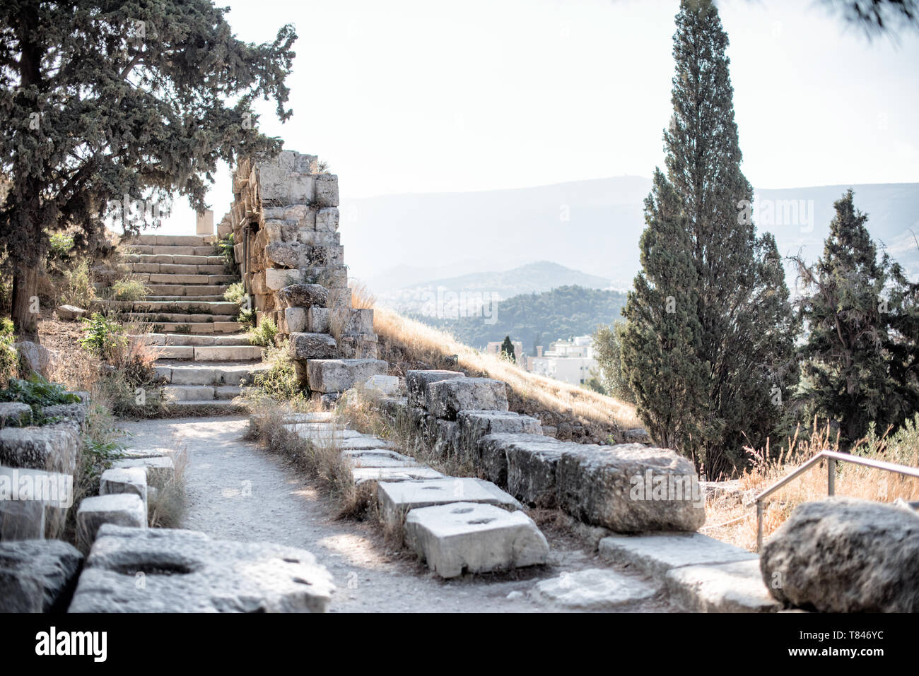 The site of an ancient bronze foundry of the hill slopes below the Acropolis of Athens. The Acropolis is an ancient citadel standing on a rocky outcro - Stock Image