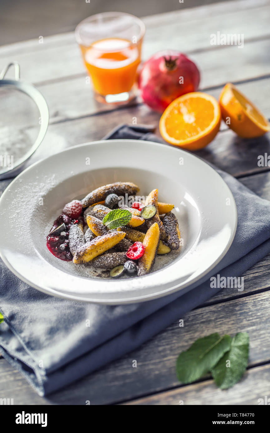 Potato dumplings sulance gnocci with milled poppy seeds shugar powder and marmalade. Traditional slovak czech and austrian sweet food - Stock Image