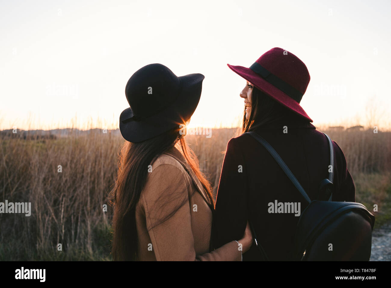 Friends talking on roadside Stock Photo