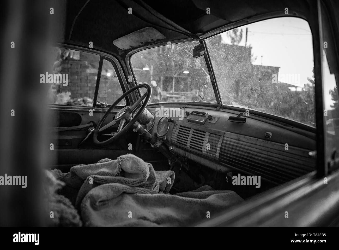 Vintage car front seat, black and white image, Nelson, Nevada, USA - Stock Image
