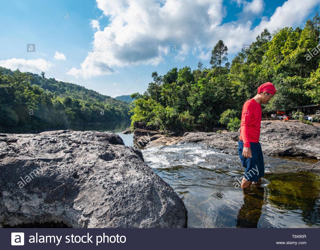 Mid adult man exploring Tatai river, Sihanoukville Province, Kampot, Cambodia - Stock Image