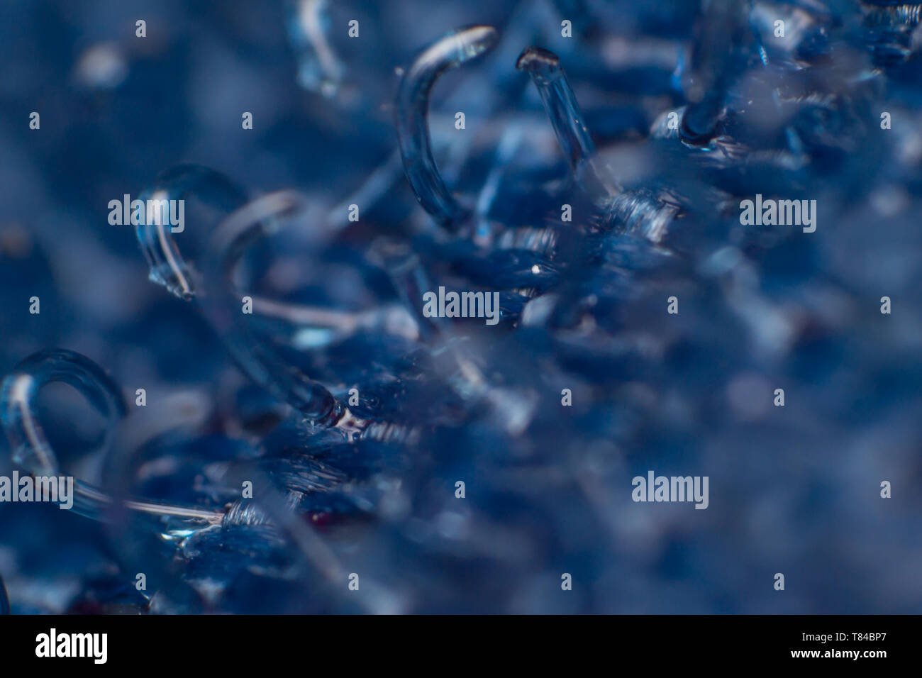extreme macro of a blue velcro texture, abstract background - Stock Image