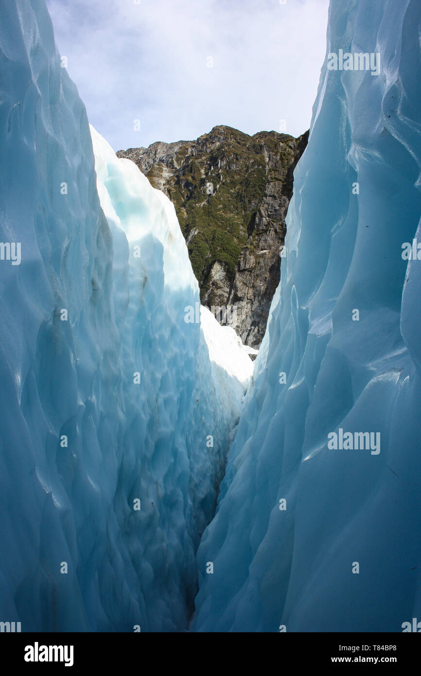Crystal blue ice on the Franz Josef Glacier, West coast, New Zealand Stock Photo