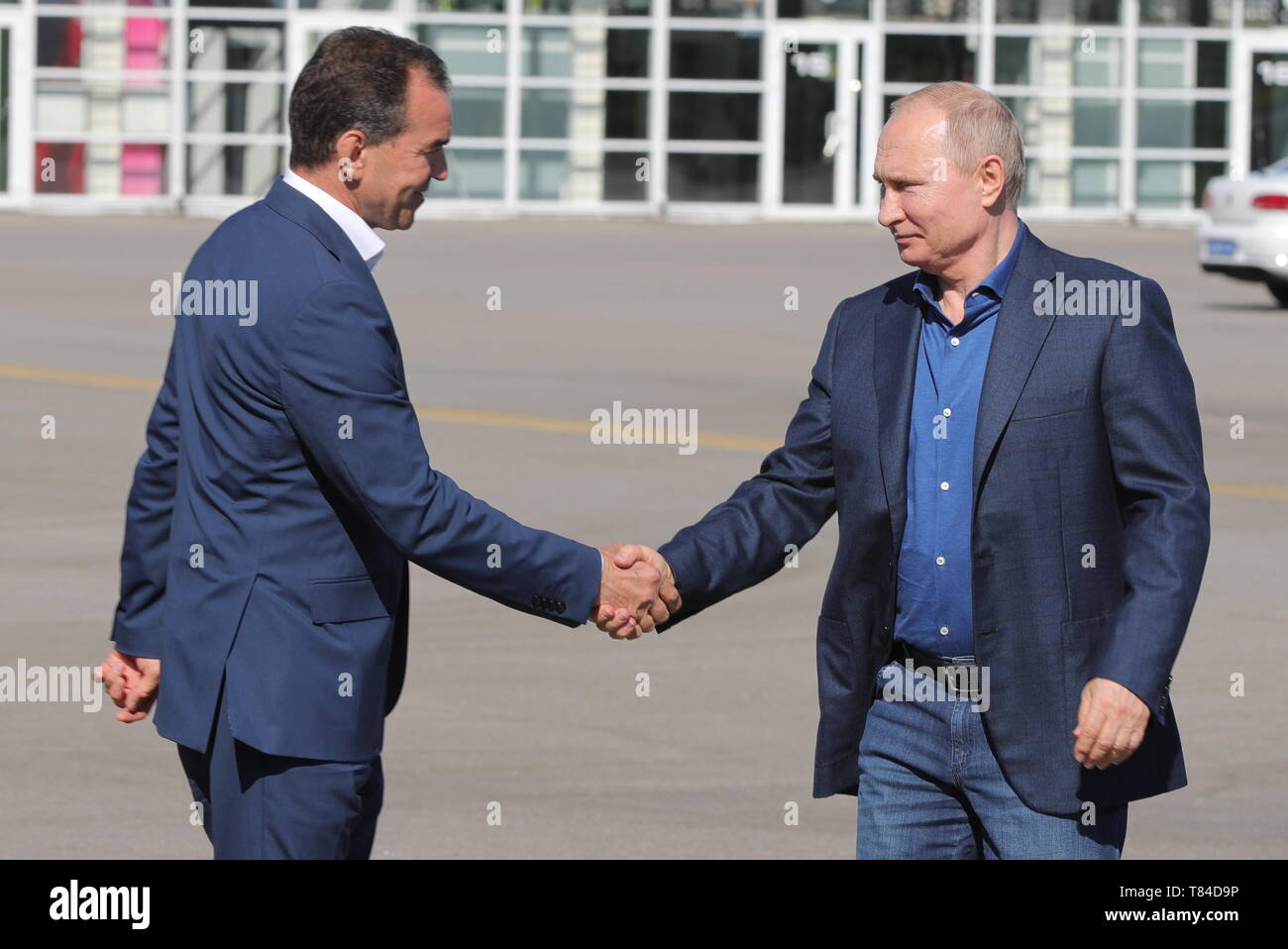 Sochi, Russia. 10th May, 2019. SOCHI, RUSSIA - MAY 10, 2019: Krasnodar Territory Governor Veniamin Kondratyev (L) and Russia's President Vladimir Putin shake hands as they visit the Sirius Education Centre. Mikhail Klimentyev/Russian Presidential Press and Information Office/TASS Credit: ITAR-TASS News Agency/Alamy Live News - Stock Image
