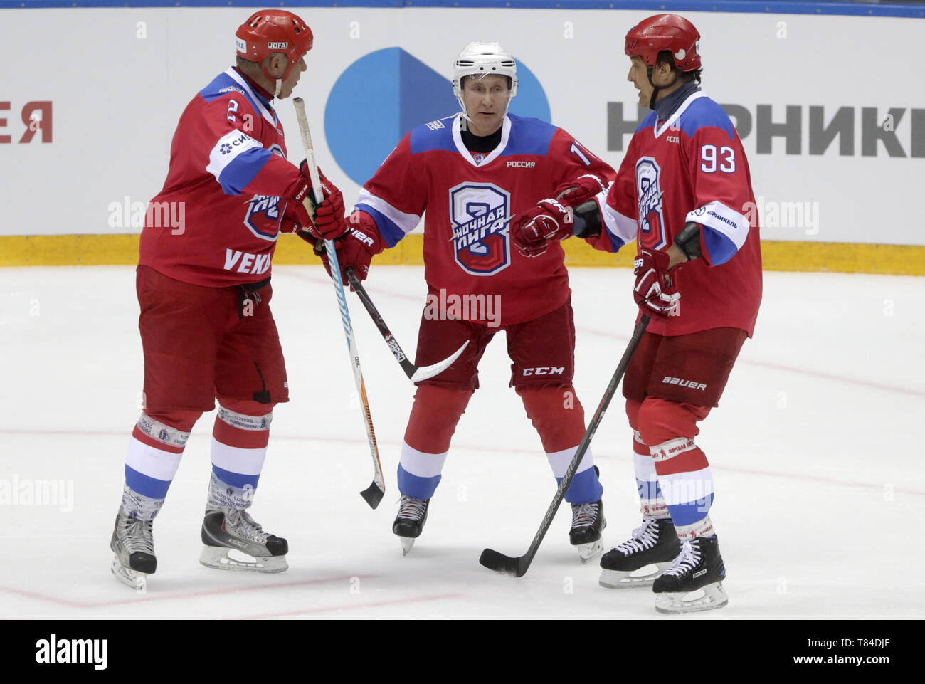 Sochi, Russia. 10th May, 2019. SOCHI, RUSSIA - MAY 10, 2019: Russian State Duma member Vyacheslav Fetisov, Russia's President Vladimir Putin, and Tula Region Governor Alexei Dyumin (L-R) in a Night Hockey League gala match at the Bolshoi Ice Palace. Mikhail Metzel/TASS Credit: ITAR-TASS News Agency/Alamy Live News - Stock Image