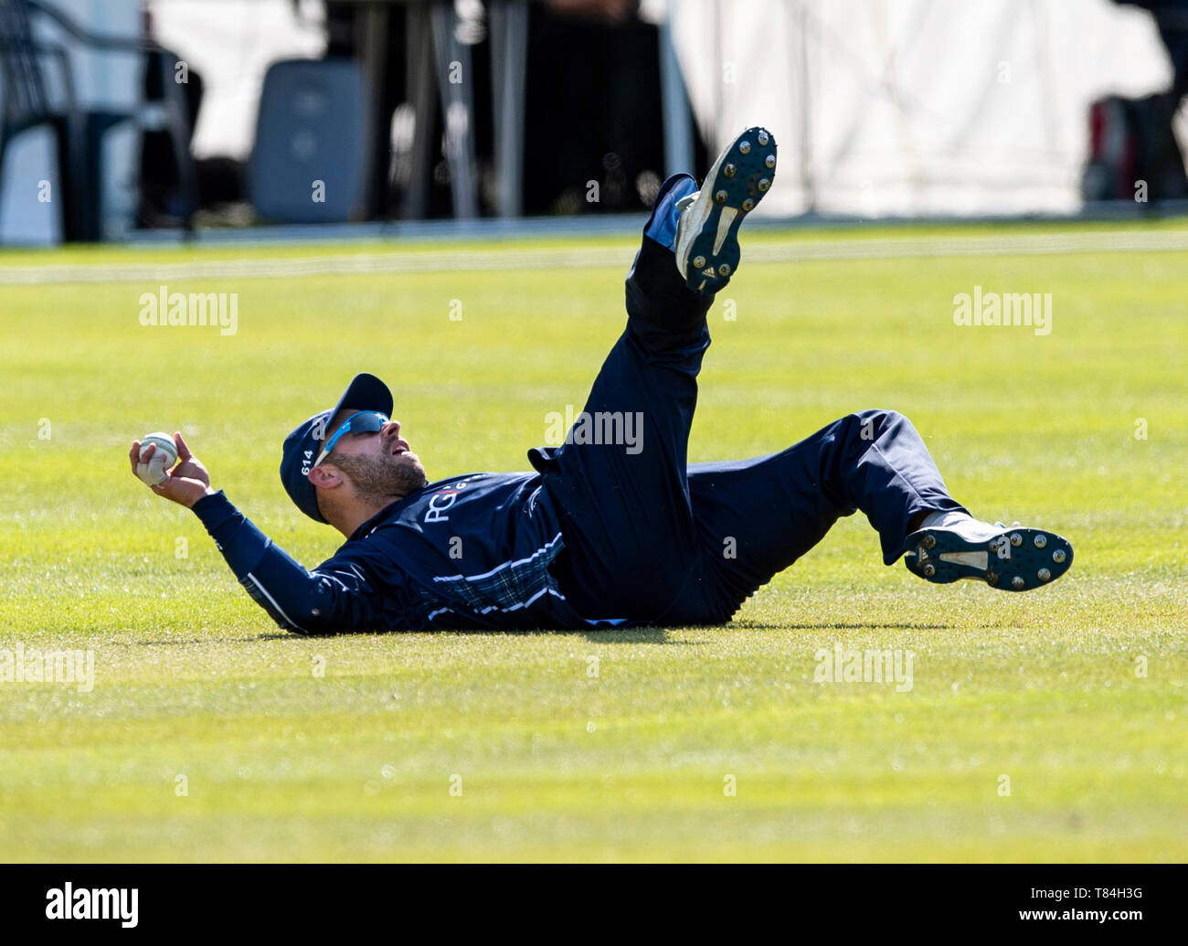 The Grange, Edinburgh, Midlothian, UK. 10th May 2019. Scotland v Afghanistan ODI. Pic shows: A brilliant catch by Scotland captain, Kyle Coetzer, to dismiss Afghanistan's Hazratullah Zazai, for 14 during the second innings as Scotland take on Afghanistan in a One Day International at the Grange, Edinburgh Credit: Ian Jacobs/Alamy Live News Stock Photo