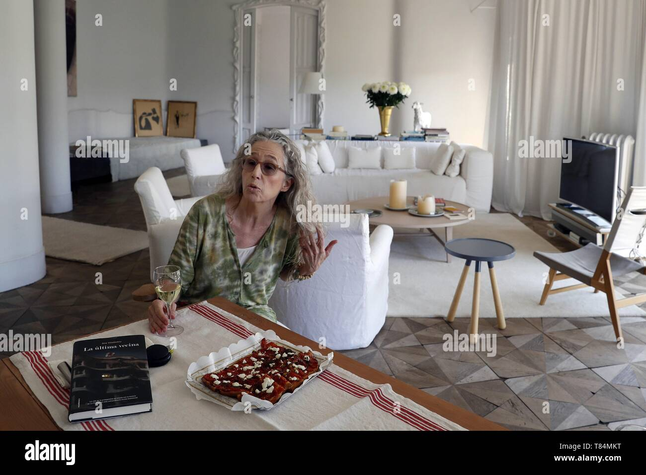 Writer Ana Viladomiu is seen at her home in Gaudi's Pedrera building in Barcelona, Spain, during an interview with Efe news agency 11 May 2019. La Pedrera is one of Barcelona's most emblematic buildings, but for Ana Viladomiu, one of the last three tenants in the building, is her home, something that has inspired her to write her third novel 'La Ultima Vecina' (lit. the last neighbor), a book in which she mixes 'fiction and autofiction'. EFE/ Toni Albir - Stock Image