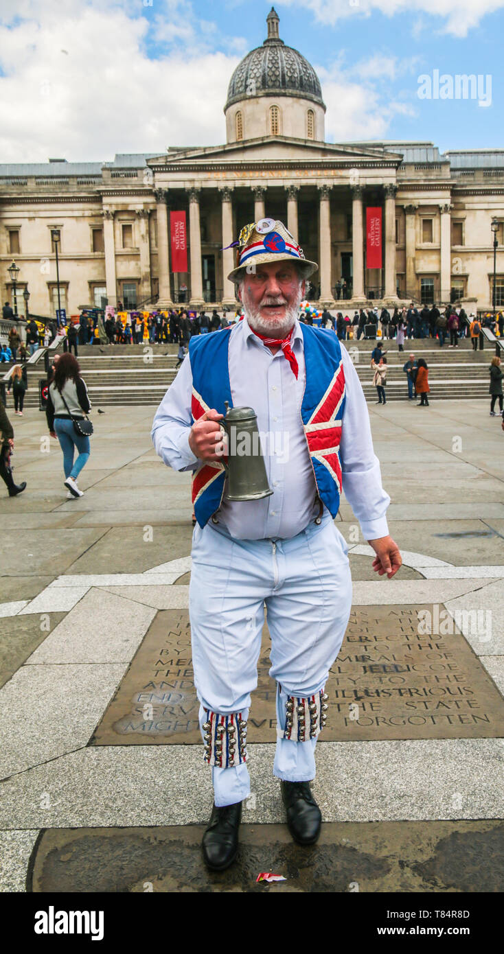 London, UK. 11th May 2019. Morris dancers ,from all over England ,decended in Trafalgar Square ,and not even the rain stopped them from having a dance in their colourful costumes and hats .Paul Quezada-Neiman/Alamy Live News Stock Photo