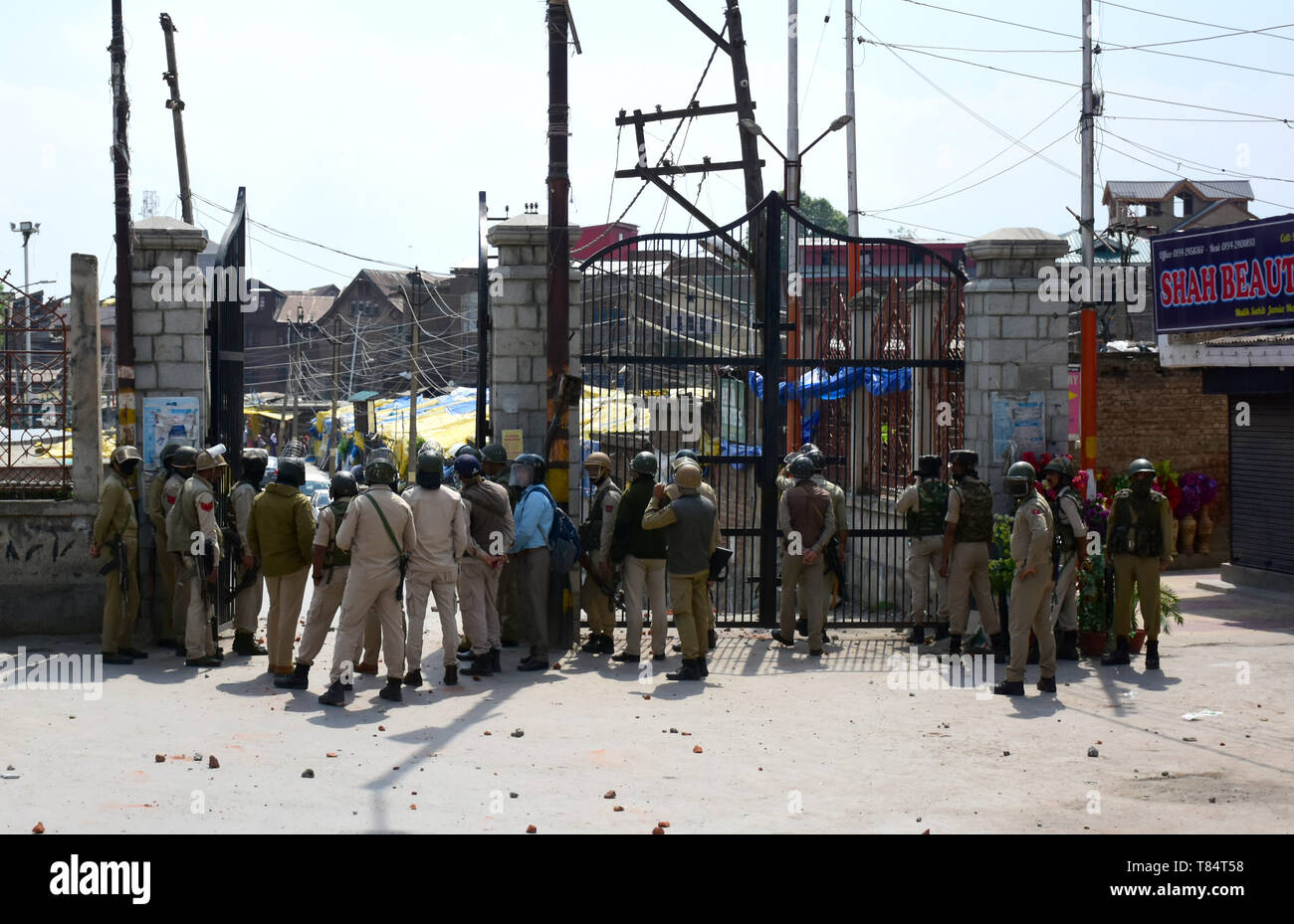 May 10, 2019 - Srinagar, Kashmir, 9 th May 2019. Hundreds of demonstrators clash with Indian government forces after the first Friday prayers of Ramadan outside the Jamia Masjid in Srinagar, in Indian Administered Kashmir. Some protesters shouted pro-freedom slogans, burnt the Indian flag, while others threw stones at Indian forces during the clashes outside the Jamia Masjid. Indian forces used teargas and pellets to disperse protesters and many demonstrators were injured during the clashes, six of whom seriously. Indian government forces arrested some of the protesters. The clashes occurred a - Stock Image