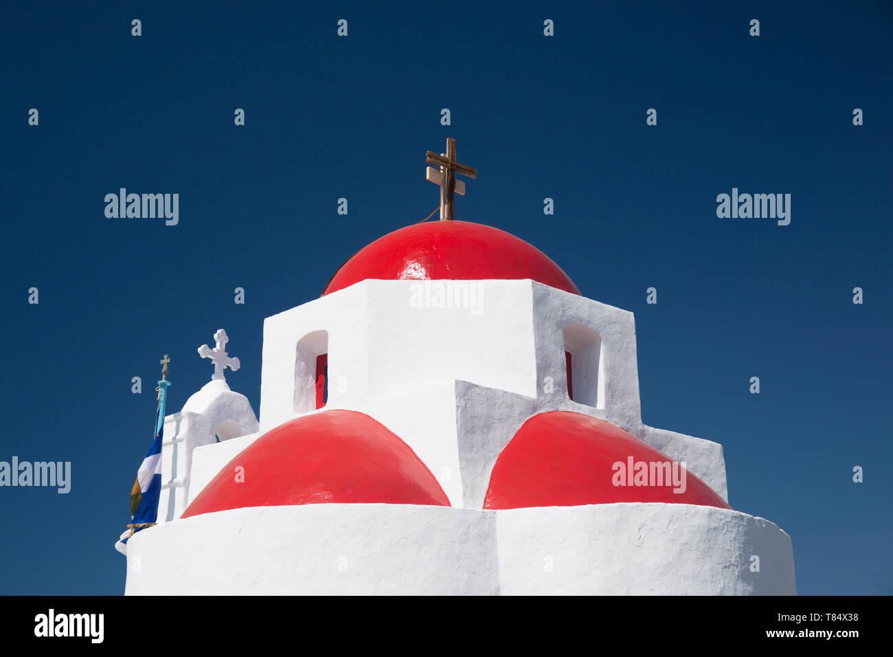 Tourlos, Mykonos, South Aegean, Greece. The red-domed Church of Agia Sofia beneath a deep blue sky. Stock Photo