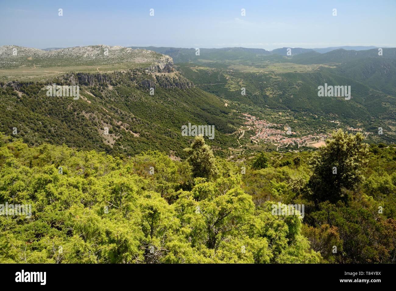Overview of Urzulei village surrounded by the Supramonte mountain range, Sardinia, Italy, June 2018. - Stock Image