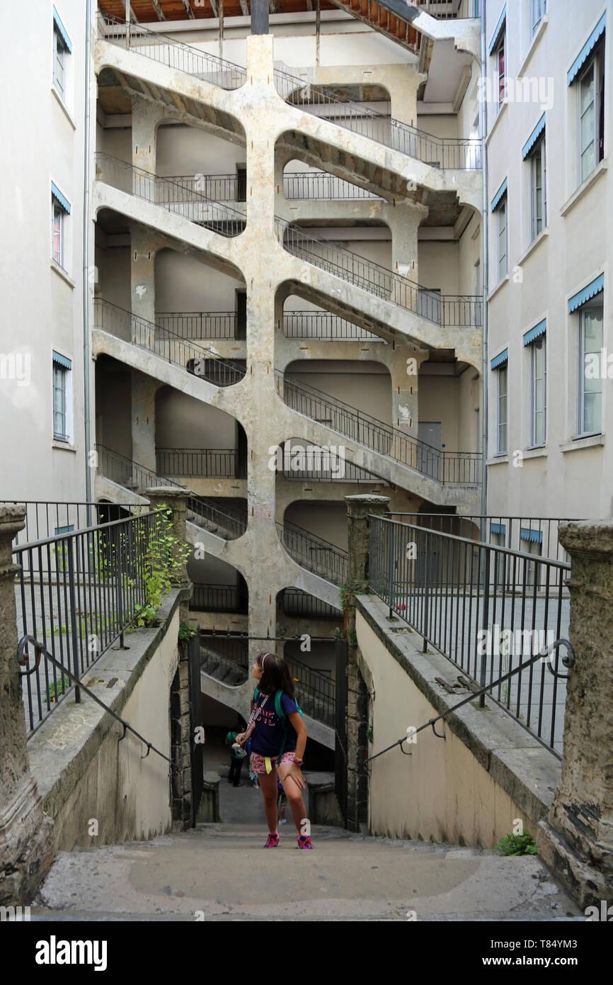 Lyon, France - August 16, 2018: big six-floor stairway called Cour des Voraces or Maison de la République and a little caucasian girl - Stock Image