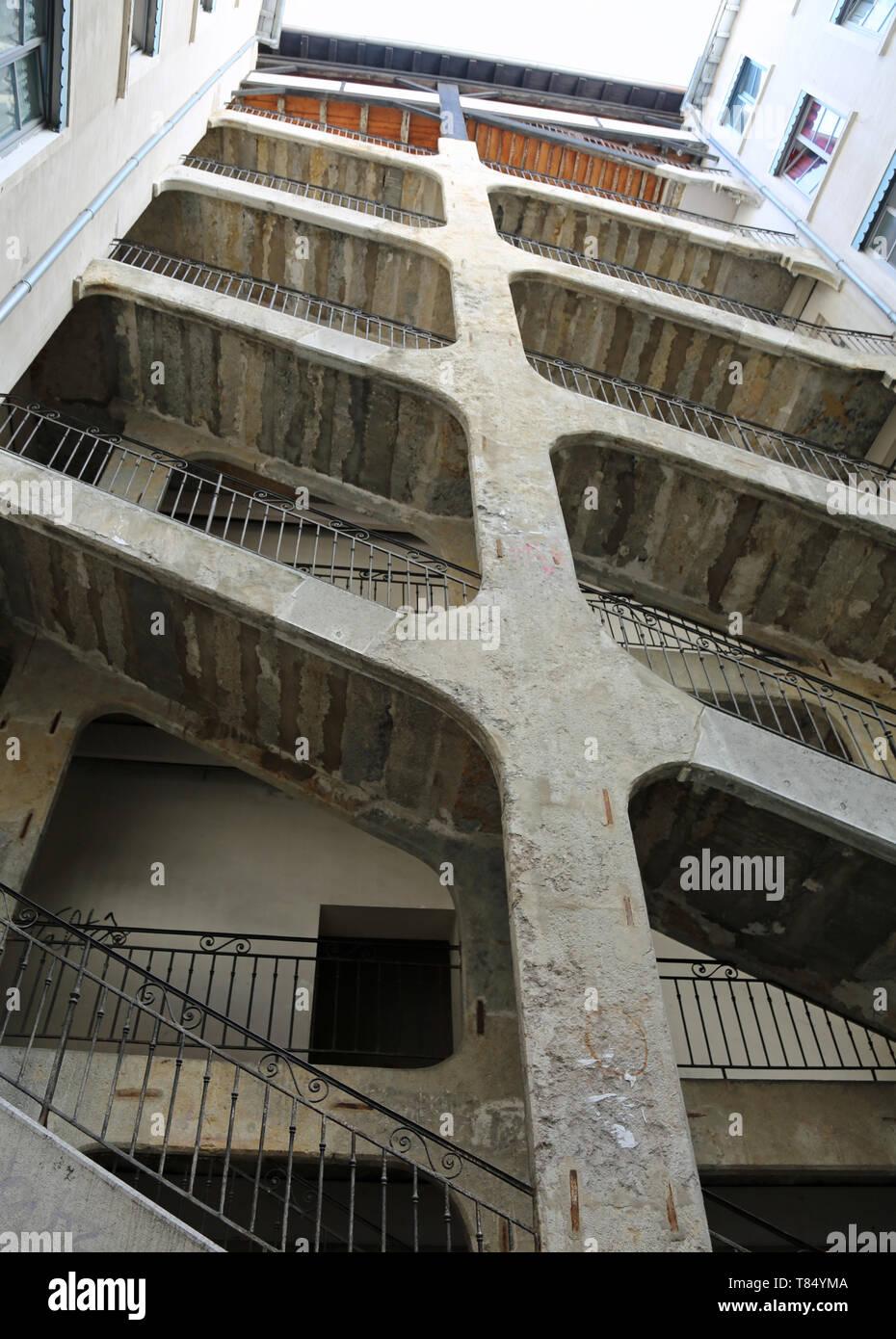 Lyon, France - August 16, 2018: six-floor stairway called Cour des Voraces or Maison de la République seen from below - Stock Image