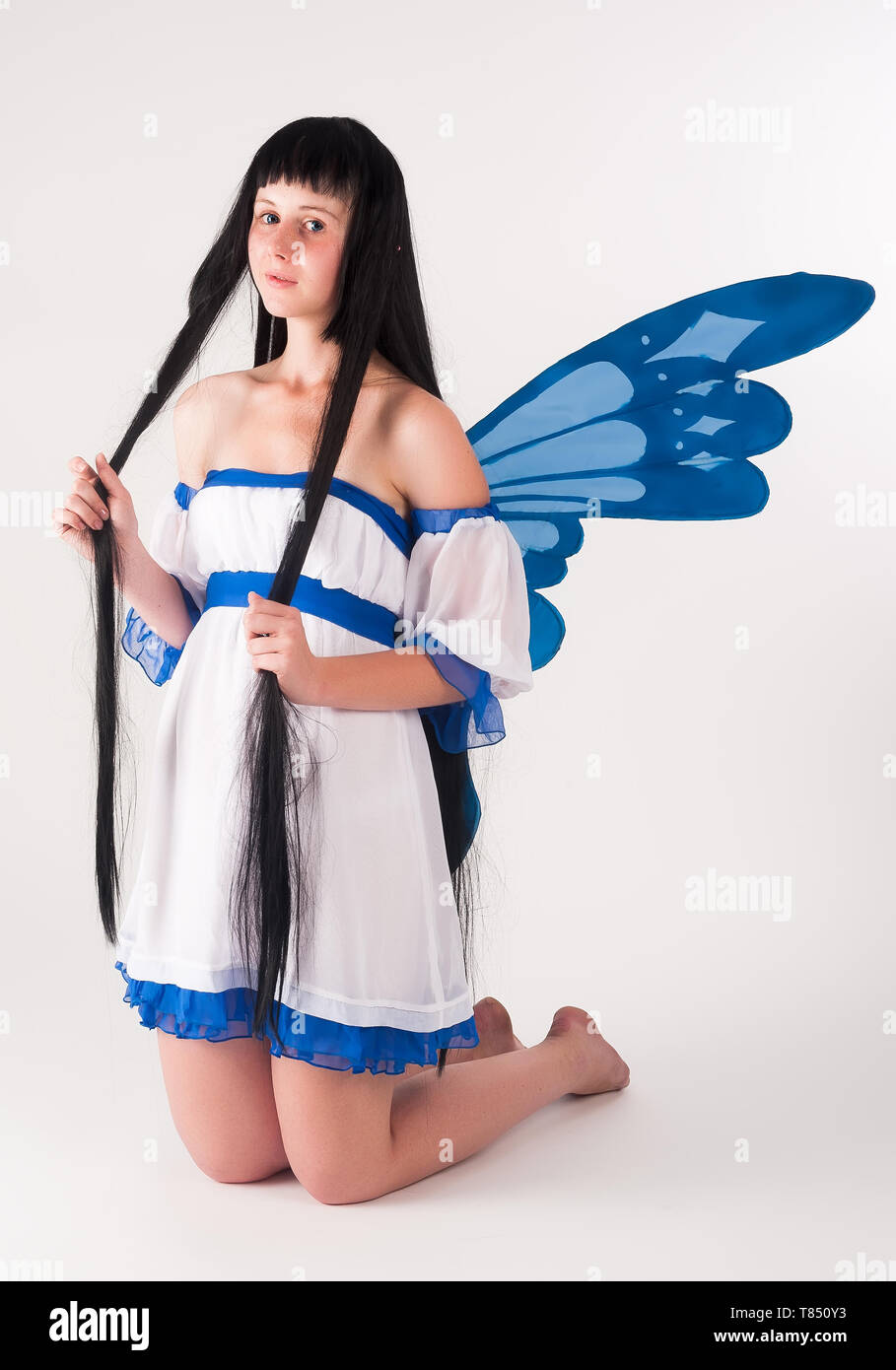 Beautiful Anime Girl With Long Hair And Wings At White Background Stock Photo Alamy