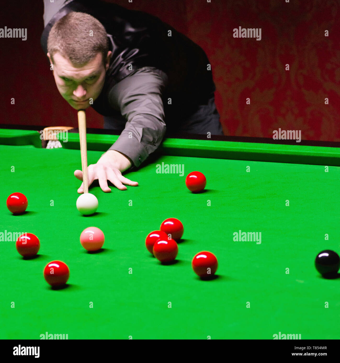 Snooker player taking a shot - Stock Image