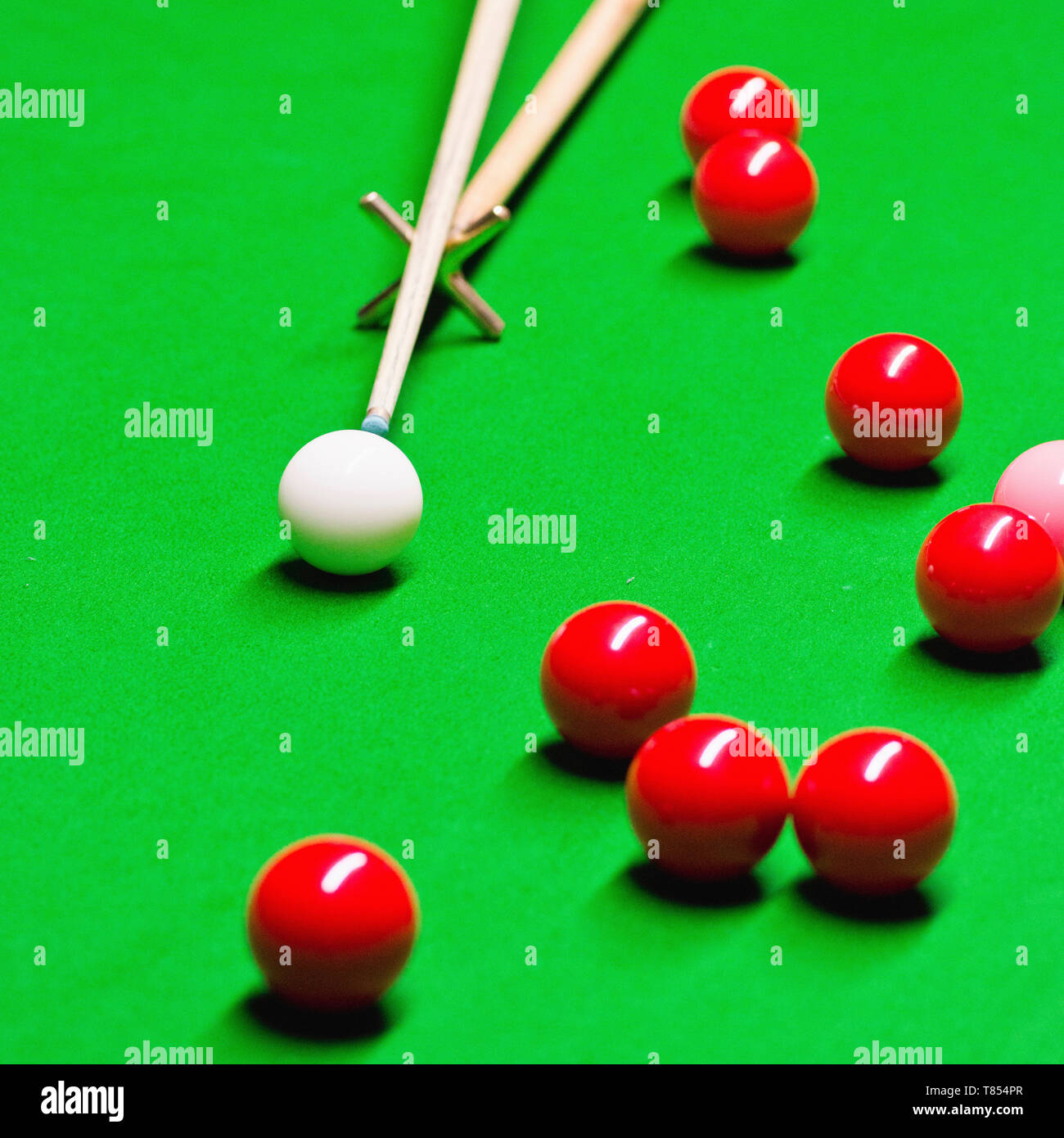 Snooker cue on rest - Stock Image