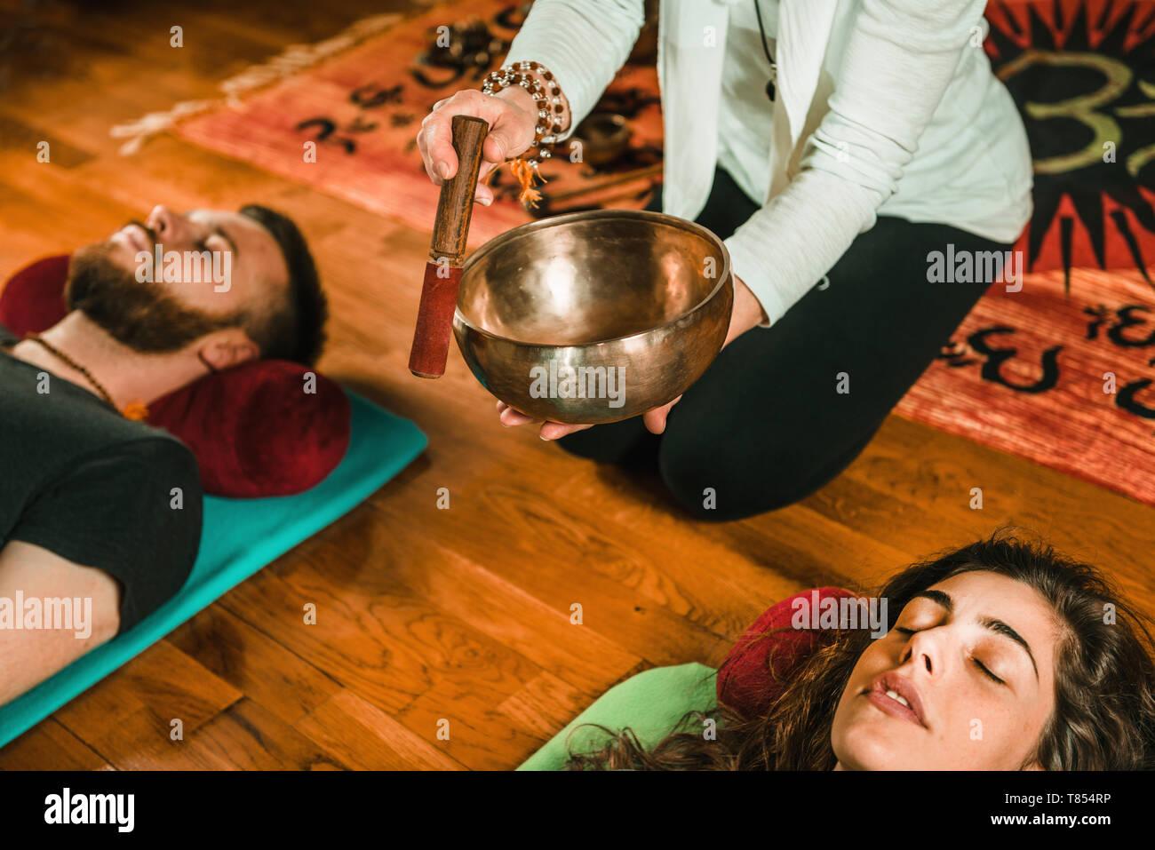 Tibetan singing bowl therapy Stock Photo