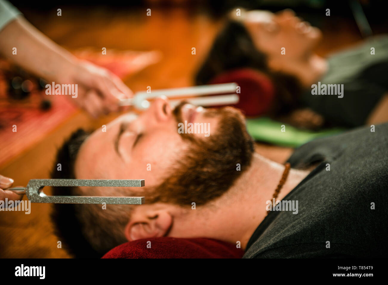 Tuning fork sound therapy Stock Photo