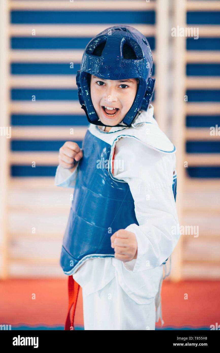 Boy in taekwondo class - Stock Image