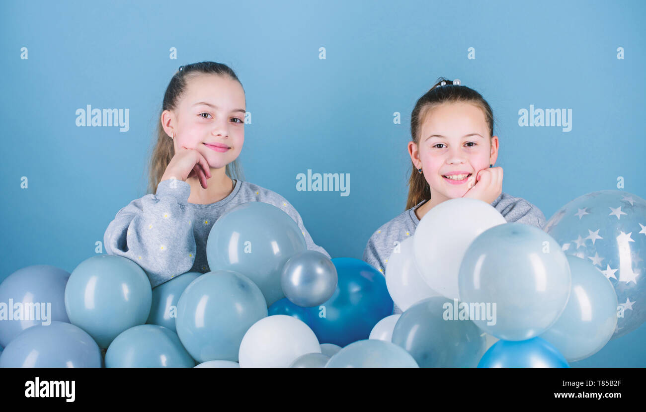 Sisters organize home party. Having fun concept. Balloon theme party. Girls best friends near air balloons. Start this party. Birthday party. Happiness and cheerful moments. Carefree childhood. - Stock Image