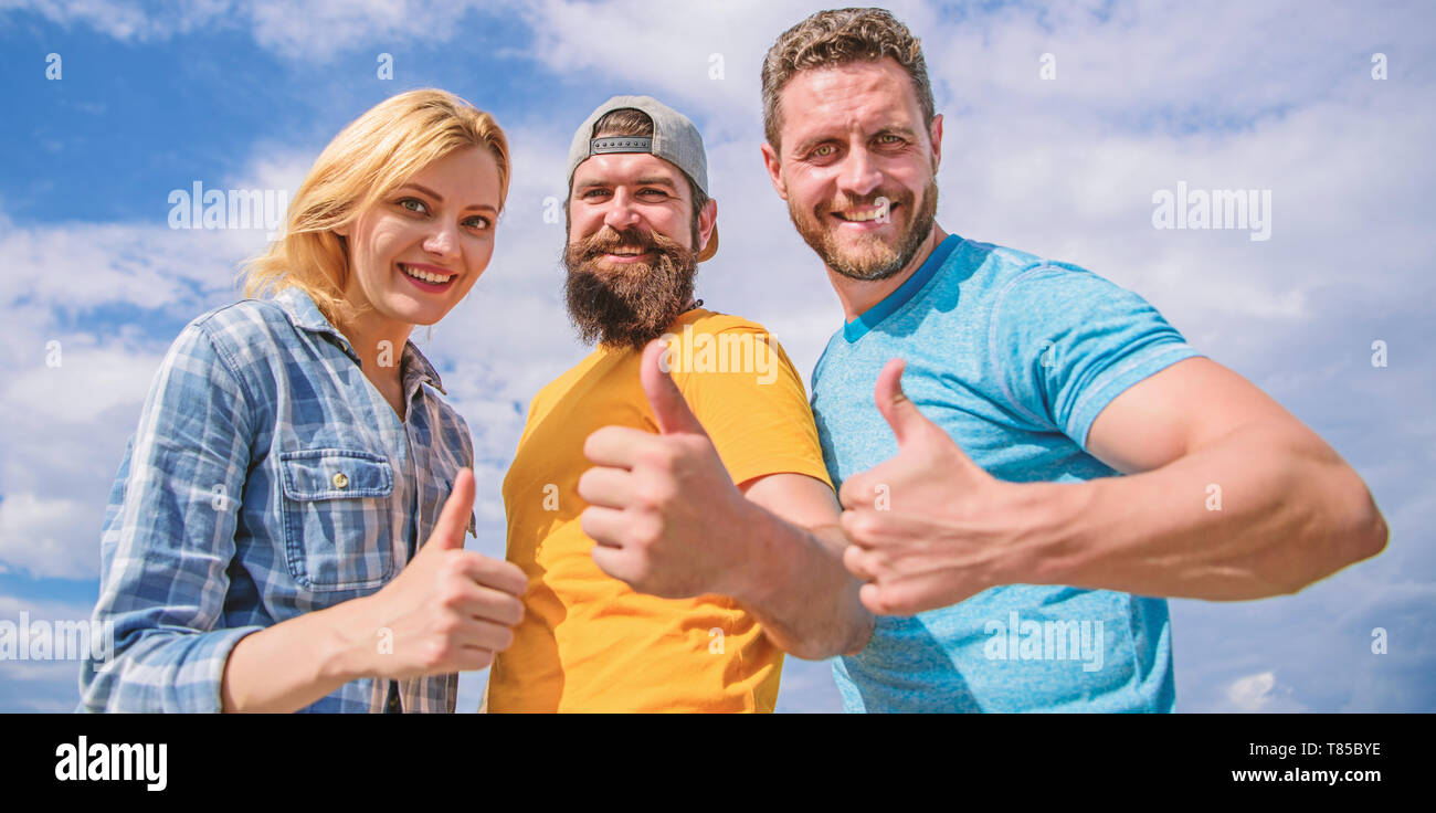 Best choice. Friends having fun summer open air festival. Men and woman enjoy summer vacation. Vacation and entertainment. Visit famous festival during vacation. Highly recommend to visit. Good job. - Stock Image