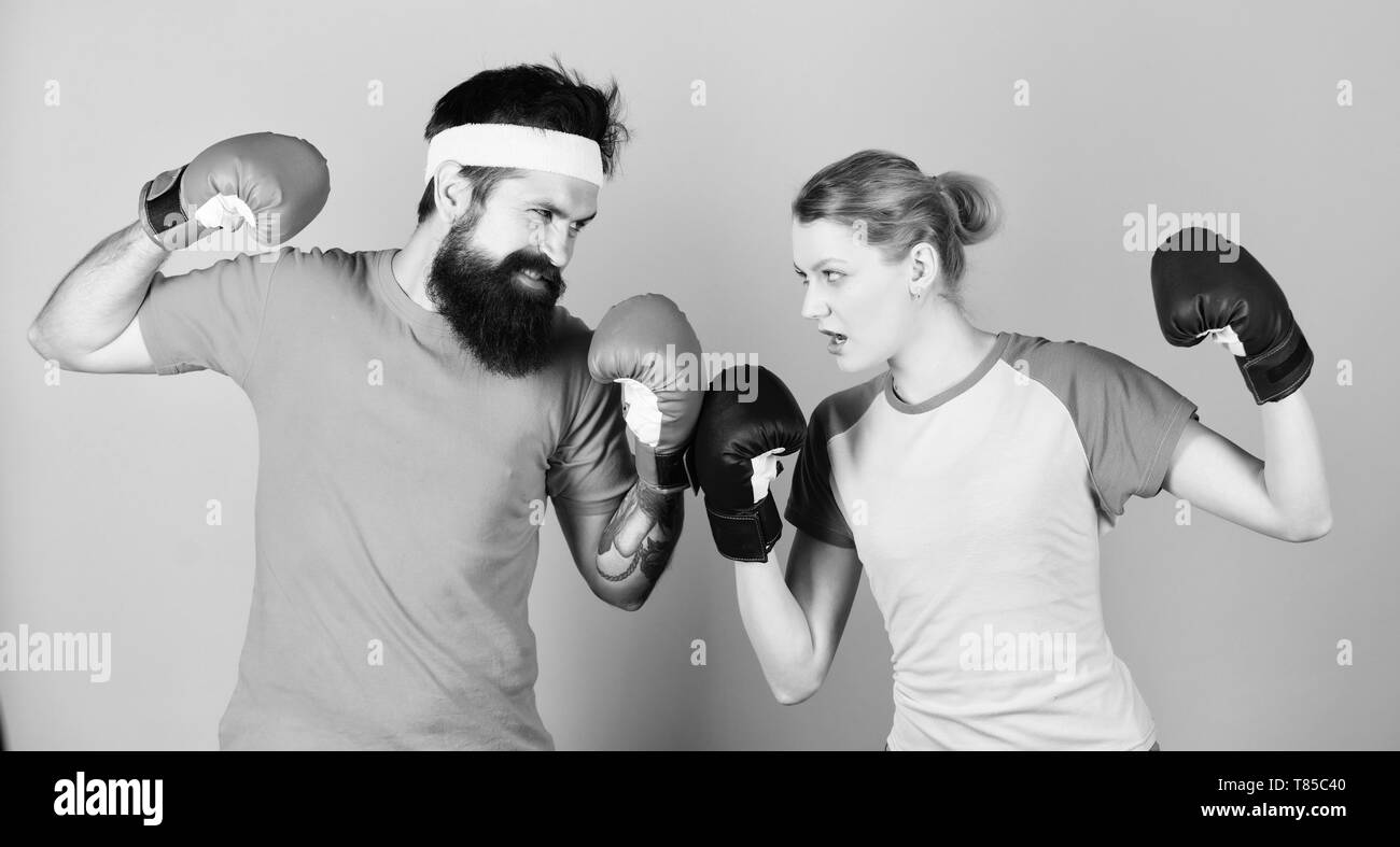 Losers complain champions train. Happy woman and bearded man workout in gym. knockout and energy. couple training in boxing gloves. punching, sport Success. sportswear. Fight. training with coach. - Stock Image