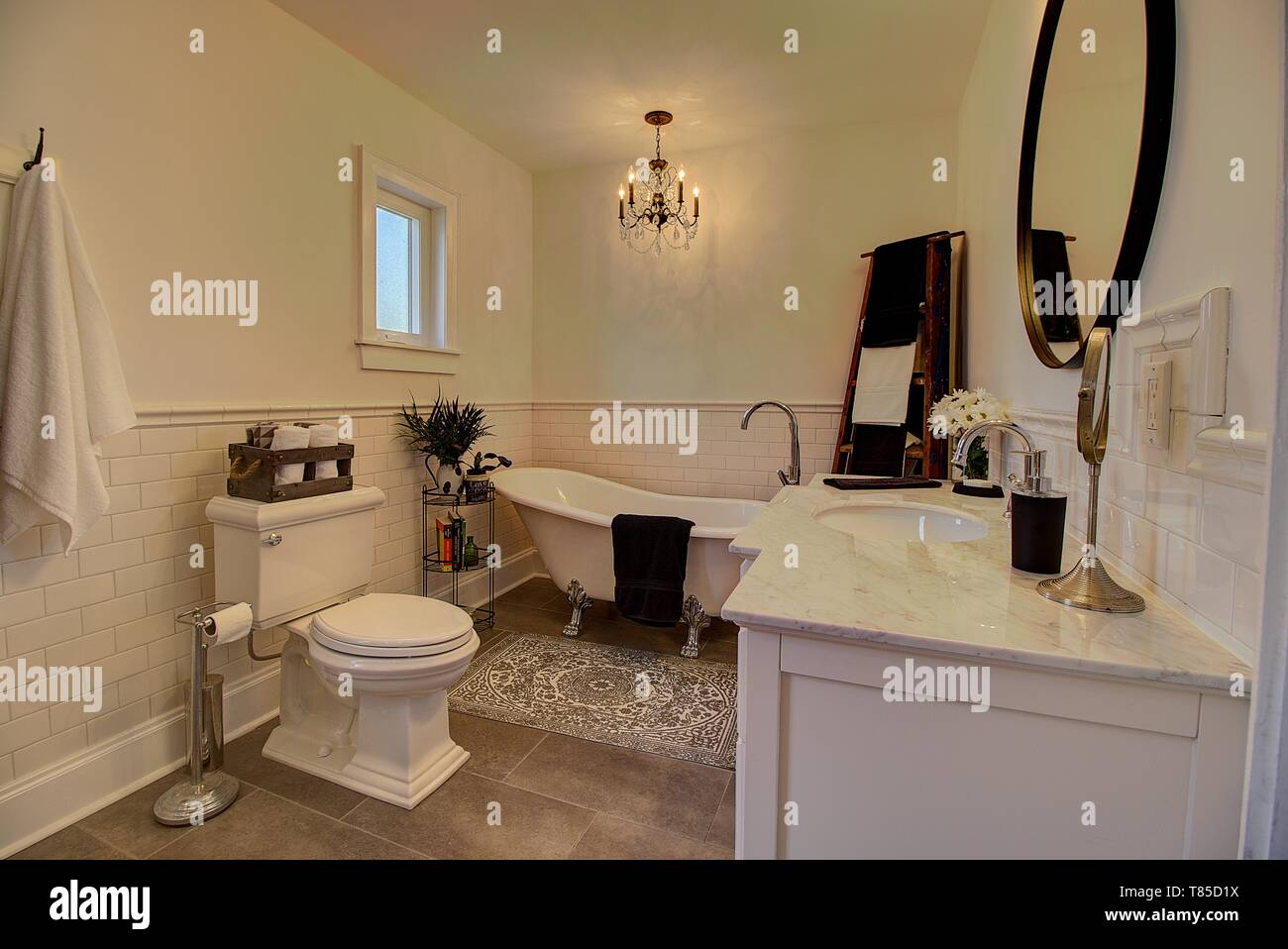 Newly renovated bathroom with claw foot tub and subway tile. - Stock Image
