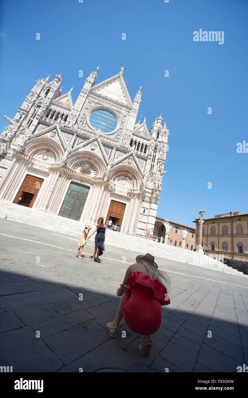 Streets, churches and famous square in the city of Siena in Italy - Stock Image