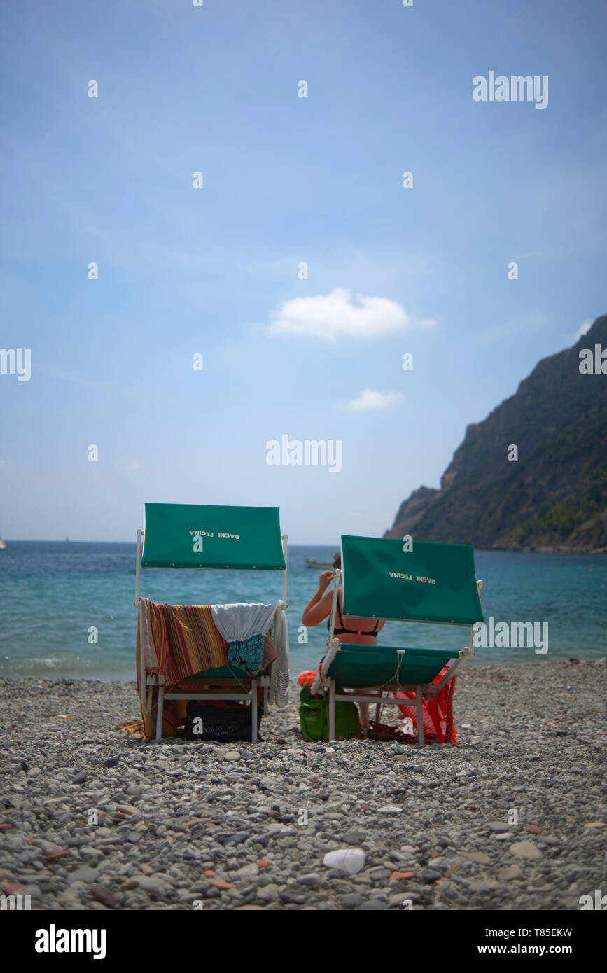 Portrait shot of two beach chair at the beach near the water in summer sunshine - Stock Image