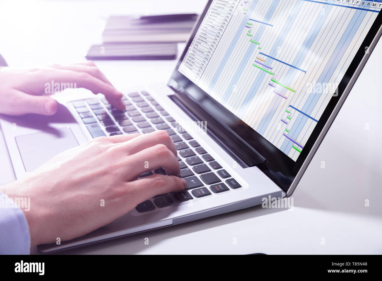 Close-up Of Businessman Analyzing Gantt Chart On Laptop In Office - Stock Image