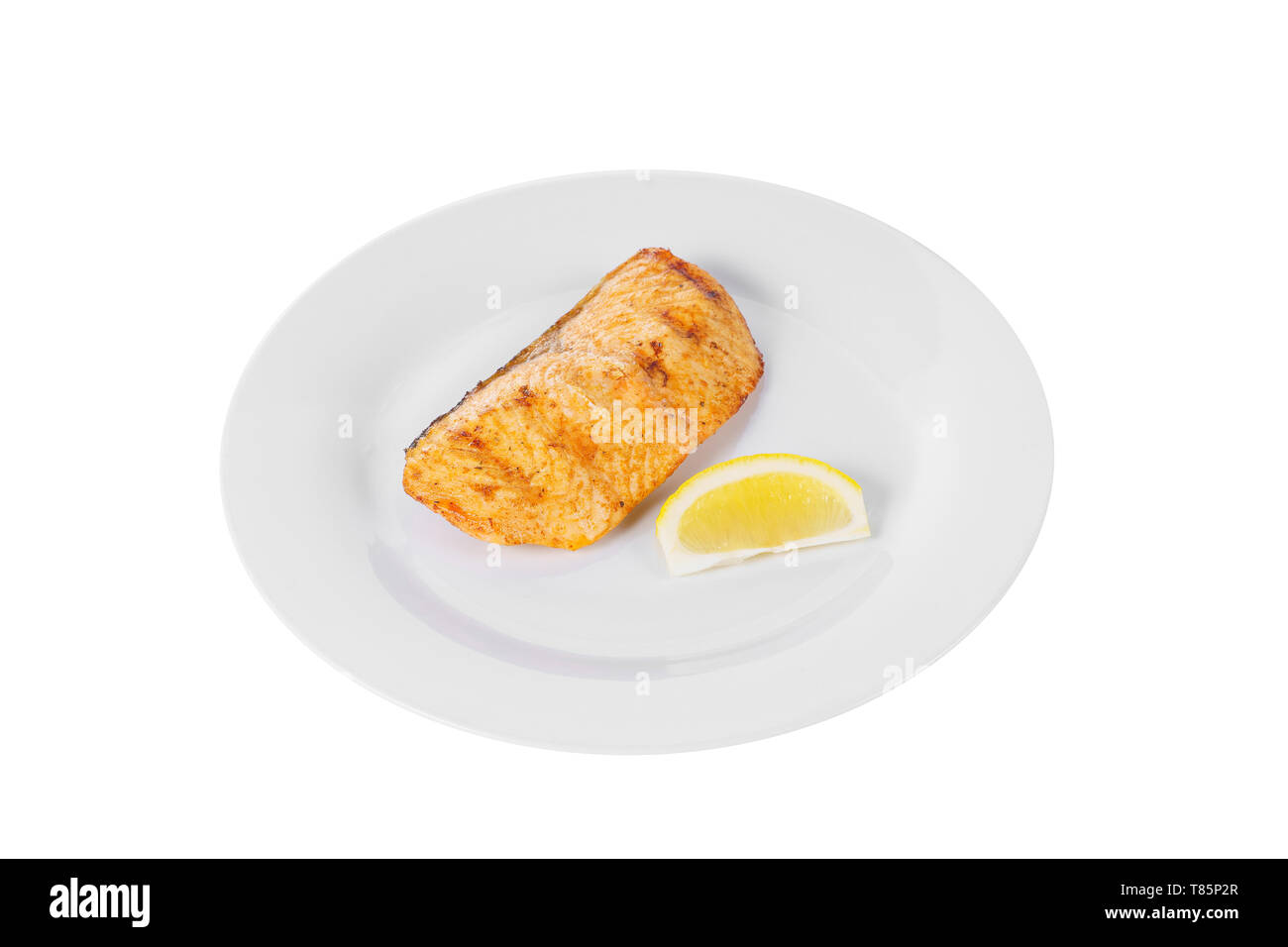 Fish, trout, keta, pink salmon, a piece, baked, fried over an open fire with a slice of lemon. Appetizing on white isolated background side view Stock Photo