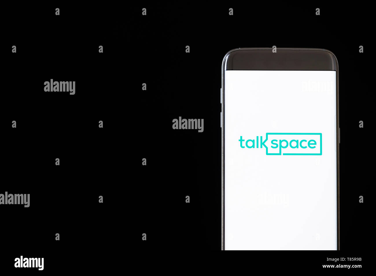 Image of Talkspace app on a smartphone on a black background Stock Photo