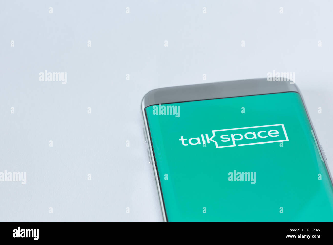 Image of Talkspace app on a smartphone on a white background - Stock Image