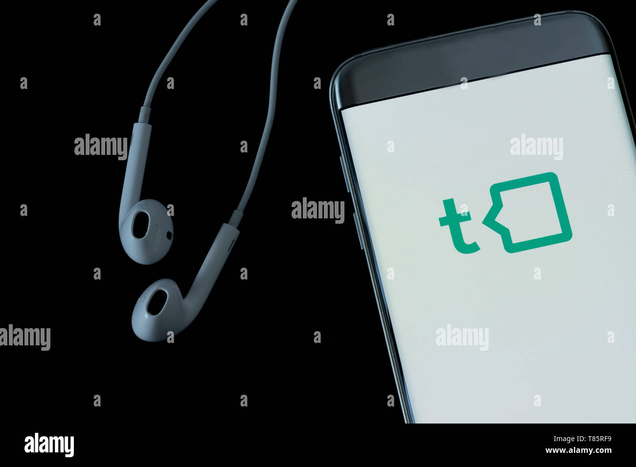 Image of Talkspace app on a smartphone on a black background - Stock Image