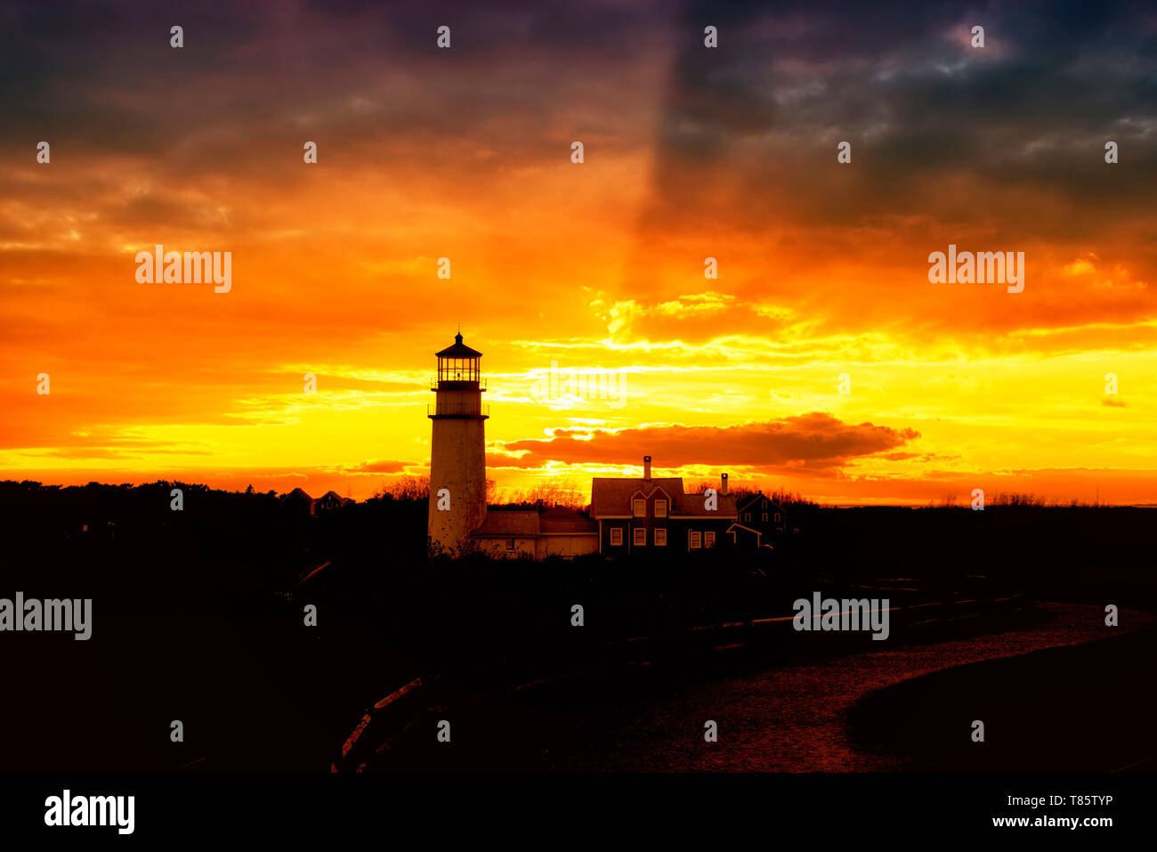 The Highland Lighthouse against a beautiful sunset in North Truro Massachusetts on the Cape Cod National Seashore. - Stock Image
